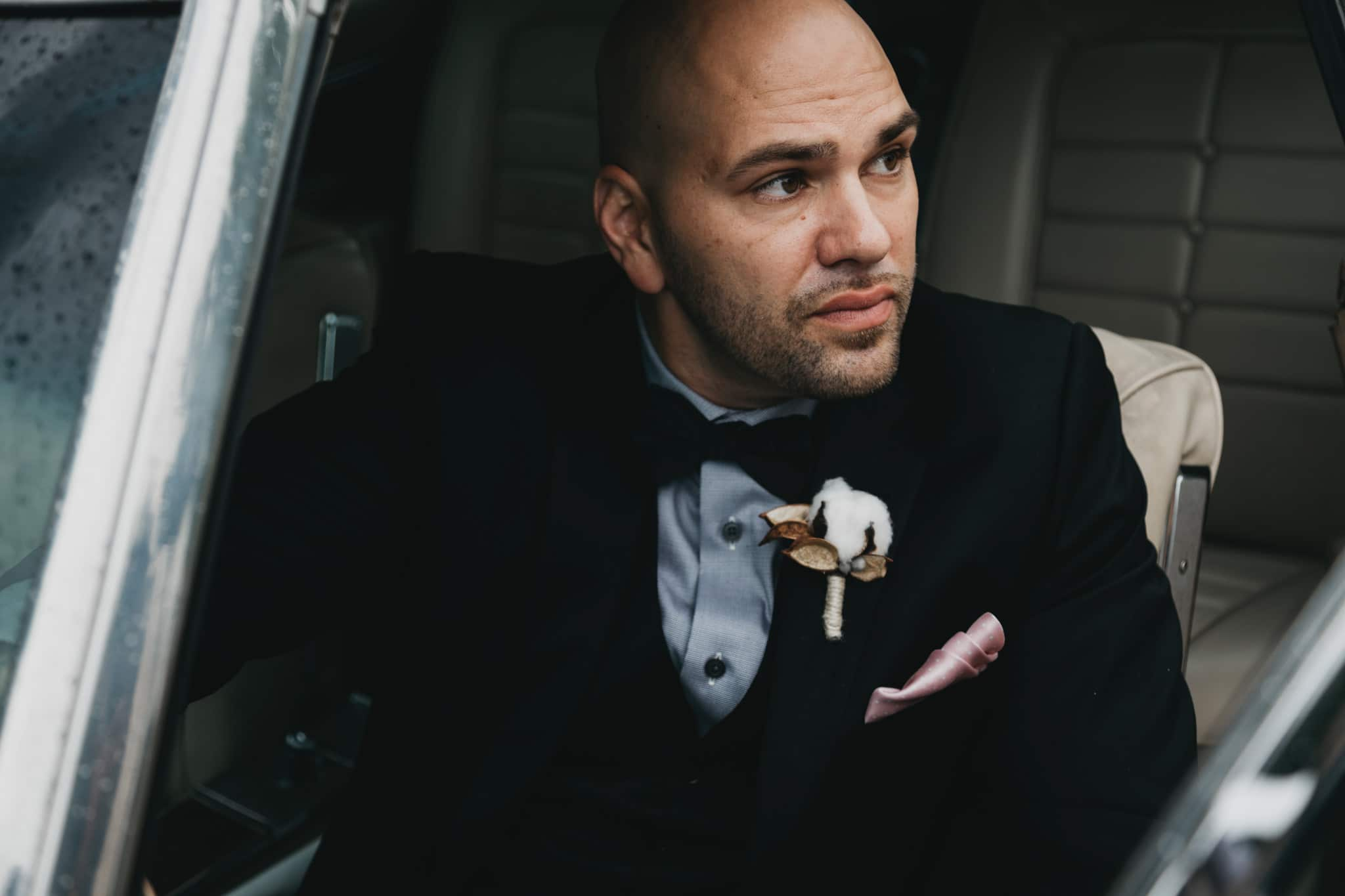 groom waiting in the getaway car